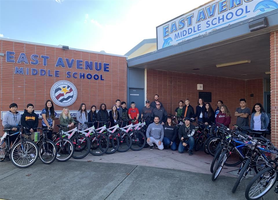Students in front of East Avenue Elementary with bicycles