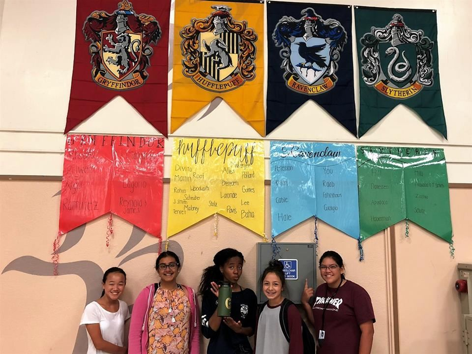 four students under house banners