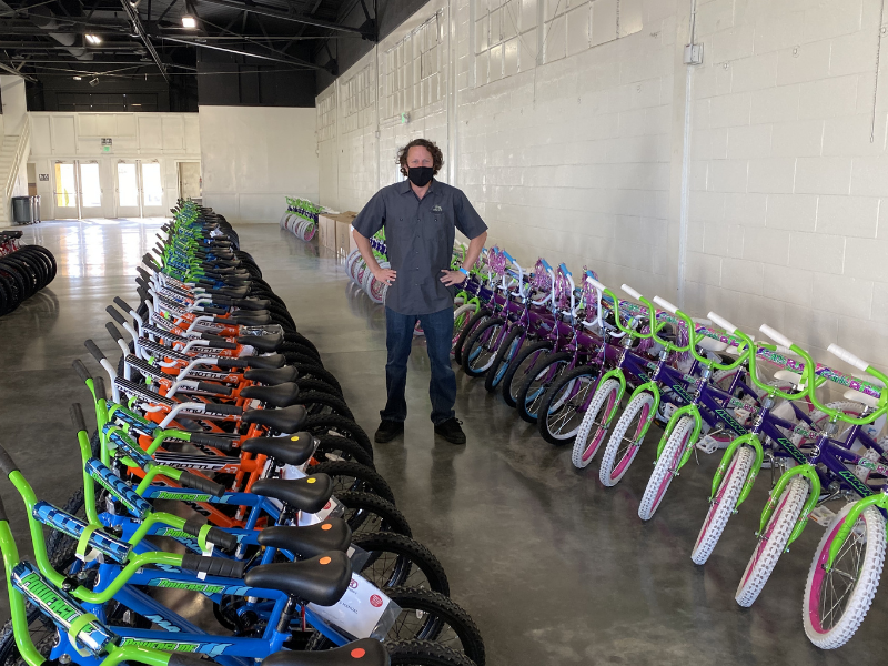 Jesse Barto with donated bikes