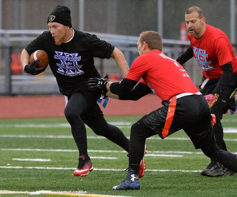 man running with football