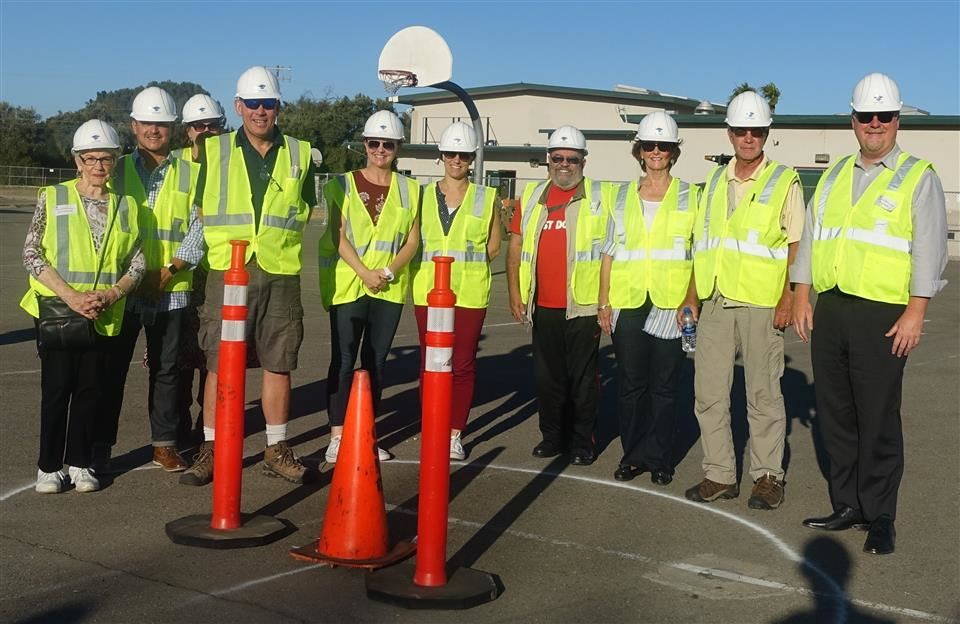 CBOC members standing on the proposed location for center court of the planned athletics complex at Livermore High School